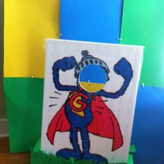 Super Grover photo stand where kids  can become him! Printed and made into a poster at Office Depot and laminated onto foam board
