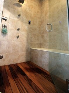 """Teak is one of the most sought-after and durable of all woods because of if it's impressive ability to stand up to the elements. It's exceptional durability makes teak wood """"green"""" because it's maintenance has very low impact on the environment and because it also doesn't require rapid replacement. Why is teak a great material for a shower floor? Well, there are some distinct advantages, such as these:  It is Durable and Strong, Waterproof, Low-Maintenance and Long-Lasting."""