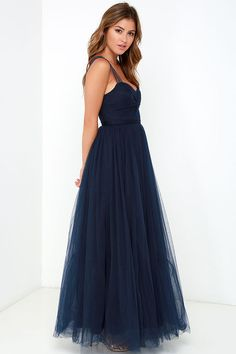 Fine and fancy, the Garden Tulle Navy Blue Maxi Dress will have heads swiveling wherever you may go! An elegant sweetheart neckline tops a knotted tulle bodice (with lightly padded cups) supported by semi-sheer shoulder straps. The tulle continues to form the banded waist, and finishes with a layered maxi skirt for a full and twirl-able look! Hidden back zipper and clasp. Fully lined. 100% Polyester. Dry Clean Only.