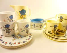 I used to have the white set! :)    Vintage 1970s Holly Hobbie Play Dishes, Play Set. $19.50, via Etsy.