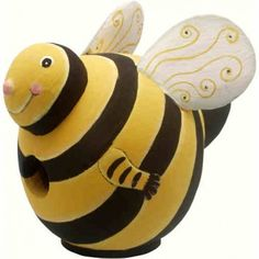 Bumblebee Shaped Birdhouse. Why not have a cute birdhouse shaped like a bumblebee to liven up your yard? Of course this bumblebee is yellow and black with white and yellow wings. And this bumblebee shaped birdhouse has a smiling face to welcome it's new tenants. No stinging here, just a dry birdhouse home for your birds. https://www.happyholidayware.com/product/bumblebee-shaped-birdhouse/