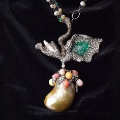 Arunashi necklace with Baroque and conch pearls, together with diamond and emerald
