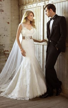This lavish Luxe Taffeta fit-and-flare designer wedding dress features a romantic removable lace overlay and dramatic low back. Sexy V-neck neckline and detachable French-wide satin sash add wow to this breathtaking ensemble.
