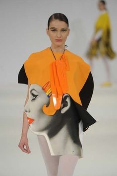 We love this 60s inspired photo print top with a pop of one of the hottest colours this season - orange! Designed by Claire Acton for Graduate Fashion Week 2012. #catwalk #fashion