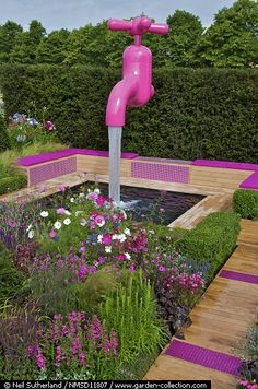 Giant Pink Tap cascading into Garden Fountain