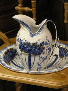 ~ Gilt decorated blue and white wash bowl and pitcher...