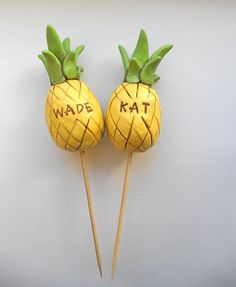 This listing is for a handcrafted polymer clay sculpture set of pineapples to top your wedding cake! They are constructed with wood dowels