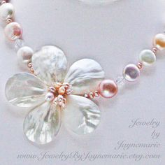 I love the natural colors of the coin pearls & the same colors in the flower center. This can also be made with all white pearls as well as bolder colors.