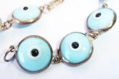 Glass bead Evil Eye bracelet by JewelryStatements on Etsy, $12.50 www.etsy.com/listing/152347117/glass-evil-eye-bracelet