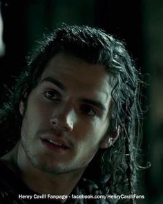 Henry Cavill... with... long hair...