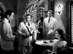 Humphrey Bogart, Claude Rains, Paul Henreid and Ingrid Bergman in Casablanca directed by Michael Curtiz, 1942