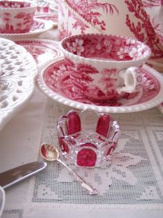 I love the way the cranberry salt cellars look with this red and white transferware china.