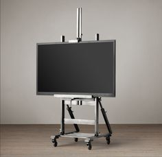Gunmetal TV Easel - gives televisions, mirrors and other wall décor a home worthy of a gallery setting. Placed on casters and fashioned from an adjustable base of metal and wood, this sturdy easel can be positioned precisely as desired. Country Interior Design, Interior Design Tips, Furniture Restoration, Restoration Hardware, Easel Tv Stand, Jenner House, Ideas Hogar, Wooden Easel, Small Furniture