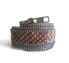 """Zippers are the new hardware for this season's fashions! My faux snakeskin zipper cuff bracelet is a classic jewelry staple that will become your favorite piece of arm candy.    The combination of steel-toothed zipper and natural looking snakeskin strikes the perfect balance between urban cool and punk chic.  This also makes a great gift for the fashion-savvy gal.    This slips on without a closure. Inner circumference 7,5""""/19cm.  It can be customized to your exact hand measurements, please…"""