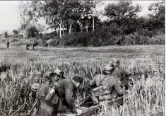 1942, Soviet Union, German infantrymen of the 6. Armee are preparing to cross a marsh near the Don on a boat