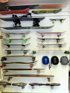 A simple way to store skateboards - simple hooks in pegboard