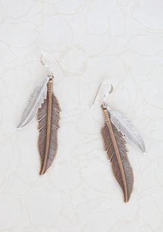 "Meaningful Feathers Earrings By Amano Studio 18.99 at shopruche.com. Textured brass and matte silver colored feathers hang from these earrings complemented with sterling silver hardware. By Amano Studio.2.75"" long, Made in USA"