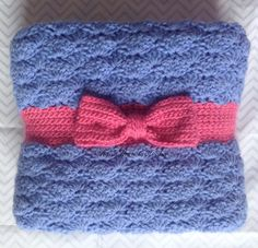 "Crochet Bow Baby Blanket $74.99 by HookYarnAndHooper This baby blanket was made in periwinkle blue and pink with a cinched ""ribbon"" and bow near the bottom. Baby soft yarn was used in this creation for snuggly comfort. Made with a growing newborn in mind with no holes for little fingers to get tangled in but the blanket is large enough to use through her toddler years. This blanket was made with love in a smoke-free home. #craftshout0415"