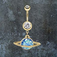 """14kt gold opal saturn belly button ring. Made with 14kt gold plated surgical steel belly button rings that is 14 gauge , and the belly bar is 3/8"""", with a blue glittery opal centered saturn charm that"""