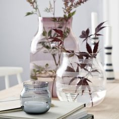 Find Kähler's iconic glass vase here. The Omaggio vase comes in mouth-blown glass in three discreet, Scandinavian shades: transparent, steel and plum.
