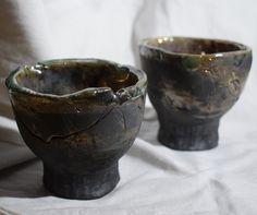Raku tea cup. Black&gold.