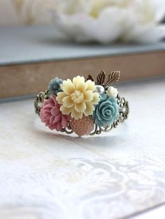 Hey, I found this really awesome Etsy listing at https://www.etsy.com/listing/159204880/ivory-blue-pink-flowers-bouquet-brass