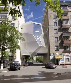 Cool looking modern building wedged between two other buildings