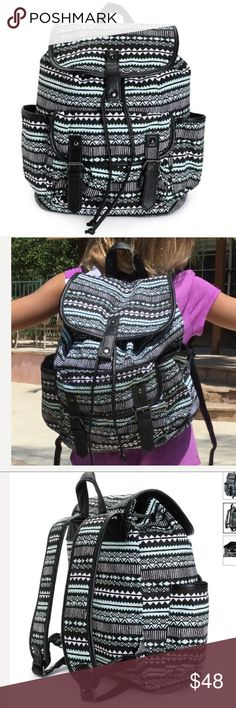 """Mint and Black Print w Black Trim Backpack Mint and black tribal print canvas with black synthetic leather trim. Taffeta lining with cinch top and magnetic snap closures. Lightly padded adjustable shoulder straps and top handle loop. 14"""" H x 15"""" W x 6"""" D. 60% cotton, 40% polyester. NWT. Inside has a zippered pocket for your phone and keys. Outside pocket 7"""" H x 9""""W x 2"""" D. Bags Backpacks"""