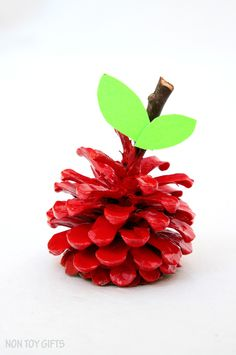Pinecone apple craft for kids. Great craft to go along with apple or fall lessons. Fun and easy nature craft for kids. | at Non Toy Gifts