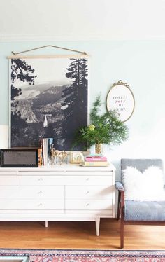 Nothing makes a room quite like a big, bold piece of art — and nothing makes a room look frumpy quite like a lonely, undersized print floating in a big expanse of white wall. But the problem, as you probably know, is that big pieces of art come with big price tags. What's a designer on a budget to do? Read on.