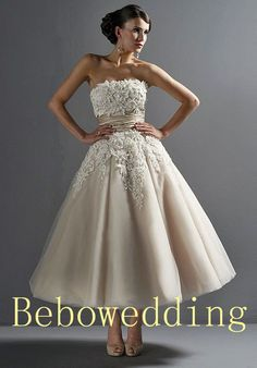 Light champagne classic tulle princess wedding gown.... Seriously love. Comes in white.