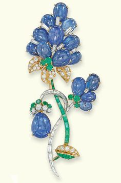 A SAPPHIRE, DIAMOND AND EMERALD BROOCH, BY MAUBOUSSIN  Designed as a series of graduated cabochon-cut sapphire petals with vari-cut diamond and emerald accents to the pavé-set diamond leaves and baguette-cut diamond and emerald stems, 9.1 cm high, with French assay marks for platinum and gold Signed Mauboussin Paris, No. 15600
