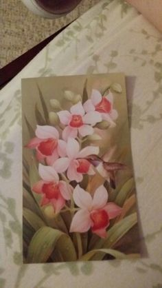 Pic I'm using for a tat in memory of my mom who passed away on 6-27-15. This is the card from her service. My sister, niece and I are doing this together. Orchids were her favorite flower.  This will be my first tat!