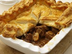 Steak and Ale Pie. Beer helps to tenderize the beef and imparts a delicious flavor. Steak Ale Pie, Steak And Ale, Slow Cooker Recipes, Beef Recipes, Cooking Recipes, Uk Recipes, Dishes Recipes, Entree Recipes, Slow Cooking
