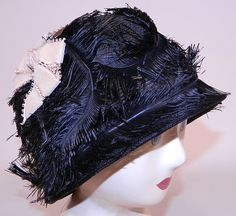 Vintage Black Feather Woven Horse Hair Straw Flapper Cloche Hat This vintage black feather woven horse hair straw flapper cloche hat dates from the 1920s.