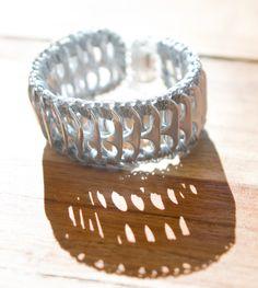 Bracelet made using crocheted soda pull tabs  |  $32  |  http://www.escamastudio.com/patra.html