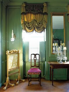 Patina pops against the green walls and ceiling in the former fashion designer Victoria Press's dining room. Read more: Victoria Press's Blithe Spirit