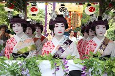 Maiko and Geiko on a float going to perform.