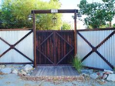 This creatively built corrugated metal fence features a decorative and function iron framework. / Maureen Gilmer, Special to The Desert Sun
