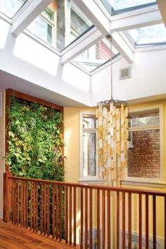 To help open and brighten the narrow row house, architect Patrick Farley carved a two-story open space above the dining room and added a skylight, which floods the interior with light.