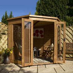 The large windows on this Windsor Contemporary Corner Wooden Summerhouse make for a light and airy atmosphere. Visit Shedstore for more information and our fantastic range of summerhouses. Wooden Playhouse Kits, Build A Playhouse, Wooden Sheds, Corner Summer House, Corner House, Summer Houses, Shiplap Wood, Plastic Sheds, Wooden Greenhouses