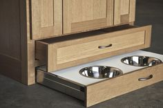 TOE-KICK STORAGE: A drawer with built-in pet bowls. Custom DeWils Pet Center. ~ Cabinet And Drawer Organizers by DeWils Custom Cabinetry