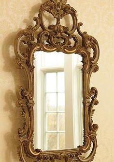 Grace any room in your home with regal elegance while adding reflective light with the St. Claire Wall Mirror.