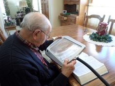 The combination of a magnifying floor lamp and a large print book have allowed my father-in-law to continue reading.