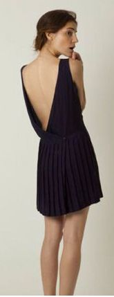 Cute black backless dress. Need the body for this one