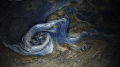 Jovian Tempest This color-enhanced image of a massive raging storm in Jupiters northern hemisphere was captured by NASAs Juno spacecraft.