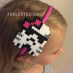 Make a geeky fashion statement with this cute Perler bead sci fi trooper helmet pixel art headband. This pink, fabric wrapped head band is adorned with a bow wearing white trooper helmet the style of your favorite epic space adventure. Our Perler designs can be placed to the left, centered, or to the right. Please indicate your desired placement when ordering. When describing your placement, please indicate the side as if you are wearing it (not looking in a mirror). Planning a perfect video…