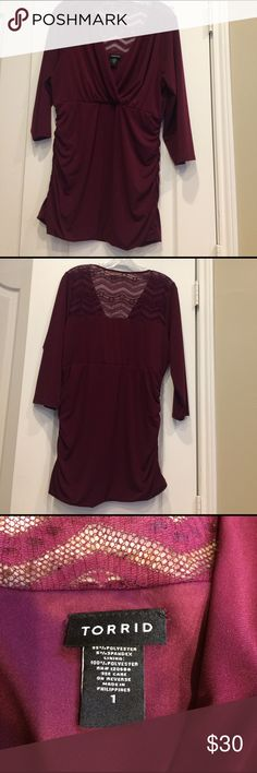 Top Torrid. Burgundy with lace on top part of back & 3/4 sleeves. Very slimming with elastic rouching on the sides. Torrid Tops Tunics