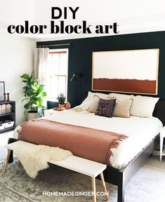 Creating a custom DIY color block art piece is easy and inexpensive to do. You can make a giant piece of artwork for your home and customize the colors to fit your personal decor.