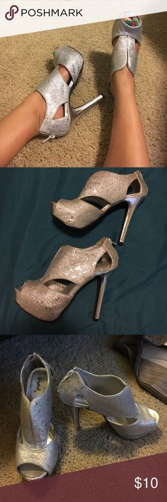 Glittery heels Silver, glittery heels. Never worn. Has a zipper in the back to secure the shoe. 1 inch platform, 4 inch heel. From a smoke free home. Feel free to make any reasonable offer. Qupid Shoes Heels